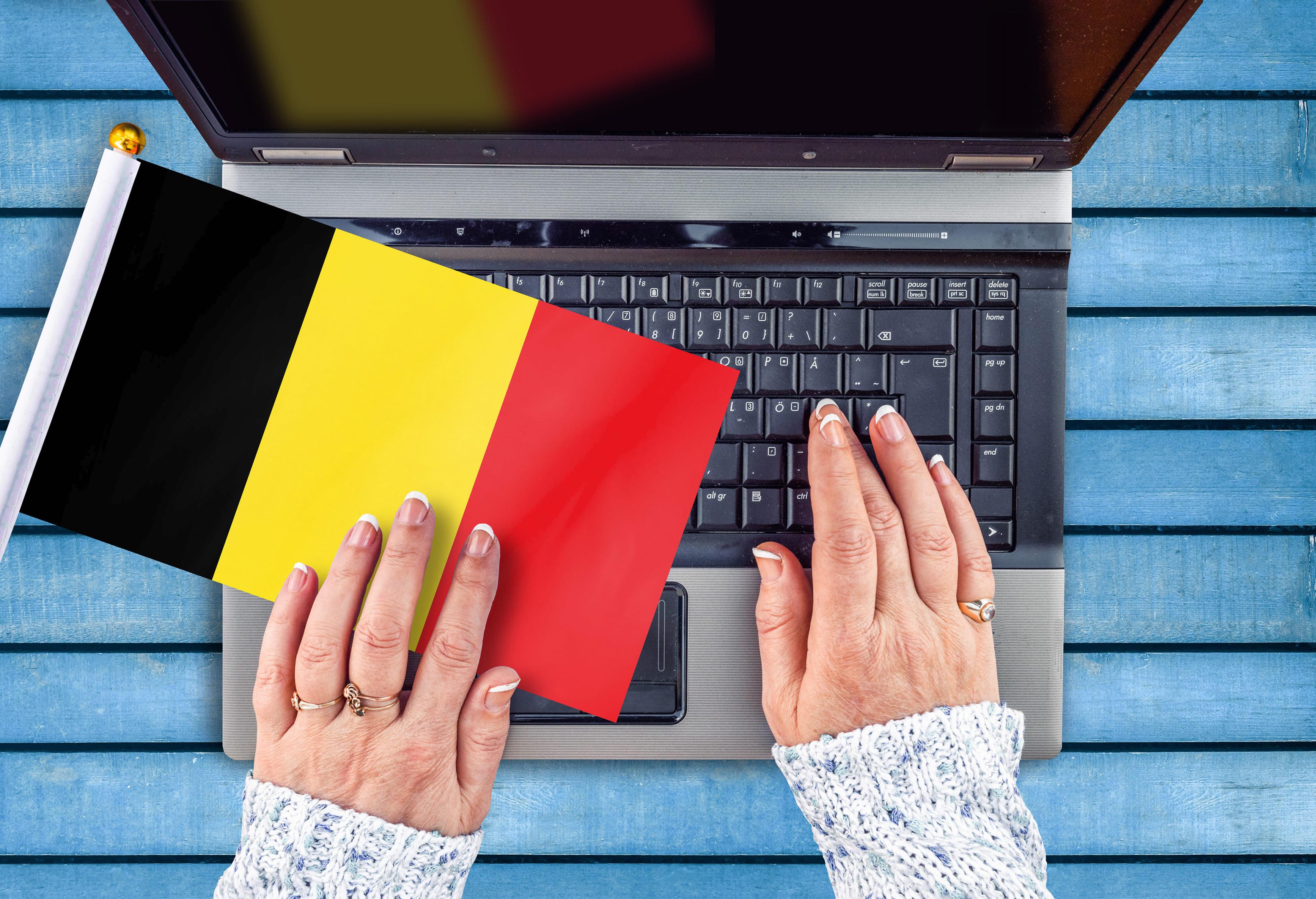 Клавиатура и флаг Бельгии, работа в которой доступна для русских